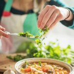 gallery-1461070309-woman-cooking-healthy-dish-web.