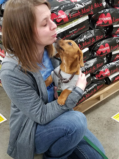 Jennifer getting puppy kisses
